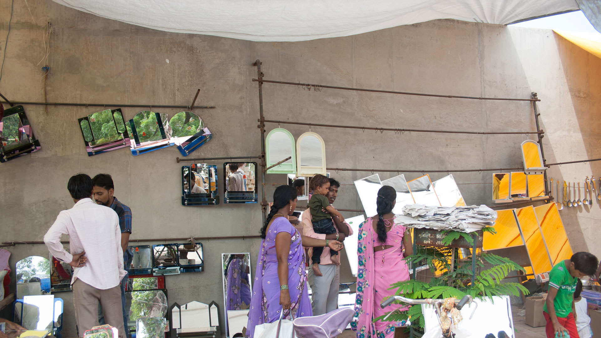 Mirrors for sale at the Ravivari Market, one of the best places for street shopping in Ahmedabad