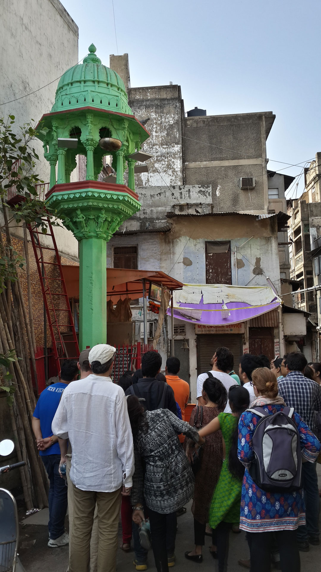 Bright green chabutro (bird feeder) in the streets of the old city in Ahmedabad