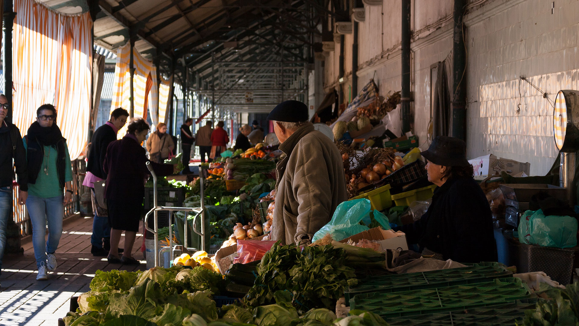 Vegetables and fruit stand at Bolhao Market in Porto