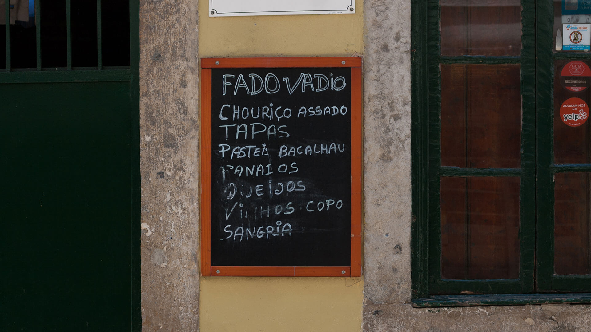 """Tasca do Chico"" in Bairro Alto advertises Fado Vadio (amateur fado)"
