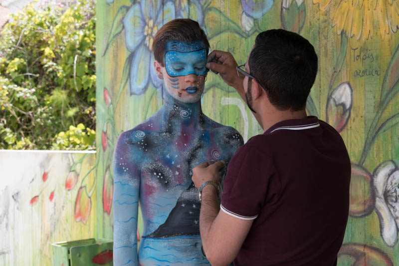 Vitor Oliveira concentrates on body painting a local model at the Azores Fringe Festival 2017