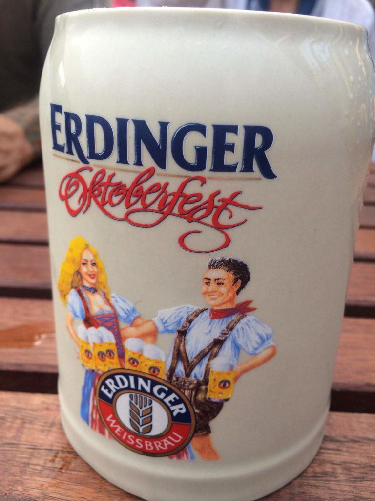 Celebrating Oktoberfest with a pint of Erdinger at Arena Sports Bar & Lounge in Maia