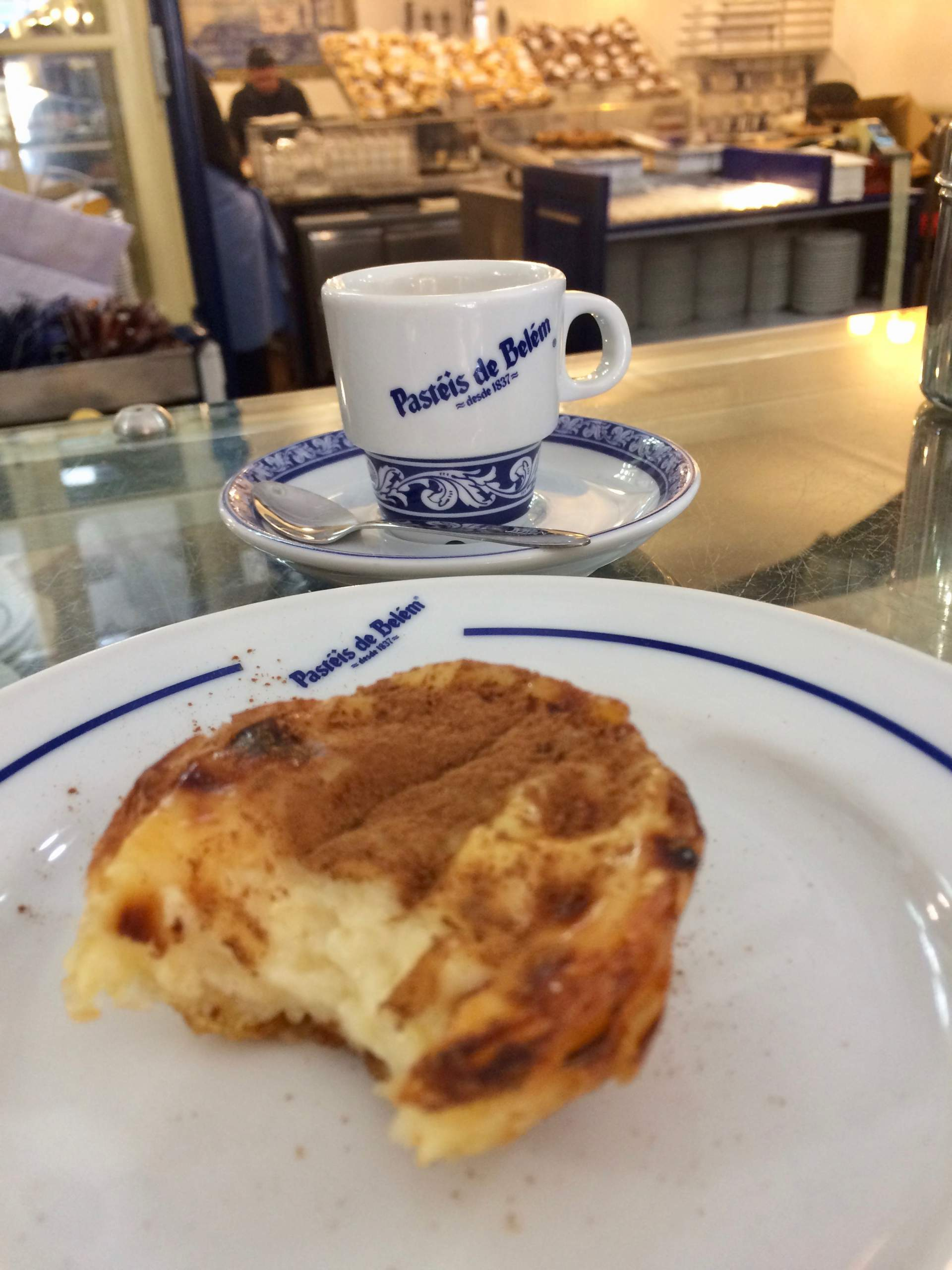 Pastel de Belém and coffee at one of the classic Lisbon coffee shops for coffee and pastries