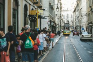Passengers waiting for tram 28 in Lisbon (photo by Paul Green via Unsplash, used as cover in a blog post about sustainable cultural tourism)