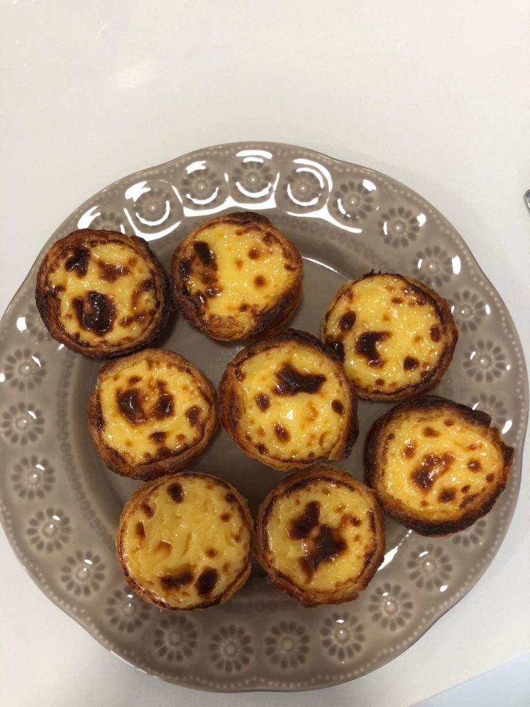 A plate of pasteis de nata freshly baked