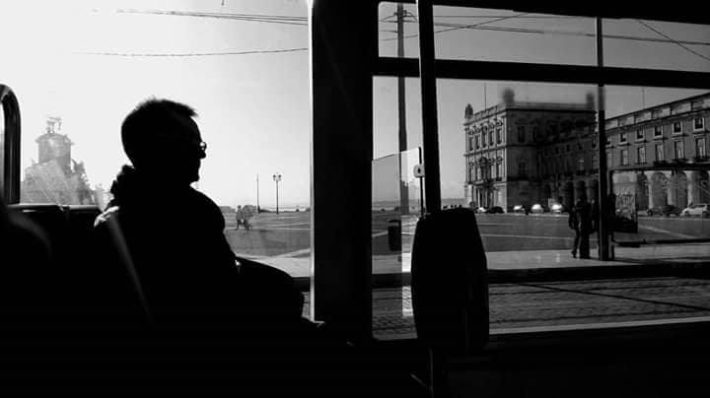 man-inside-a-bus-looking-out-the-window-copyright-bruno-miguel-castro