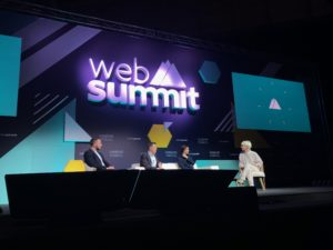 three speakers on stage during a conference at the web summit lisbon 2018