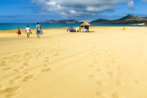 people on the beach in the Portuguese island of Porto Santo, Madeira archipelago